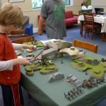 tweens play Warhammer 40K, at table top fantasy game