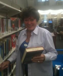 photo of Linda McEnery shelving books